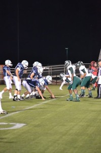 Patriot offense faces off against the Wakefield Warriors. Photo by Rachel Finley