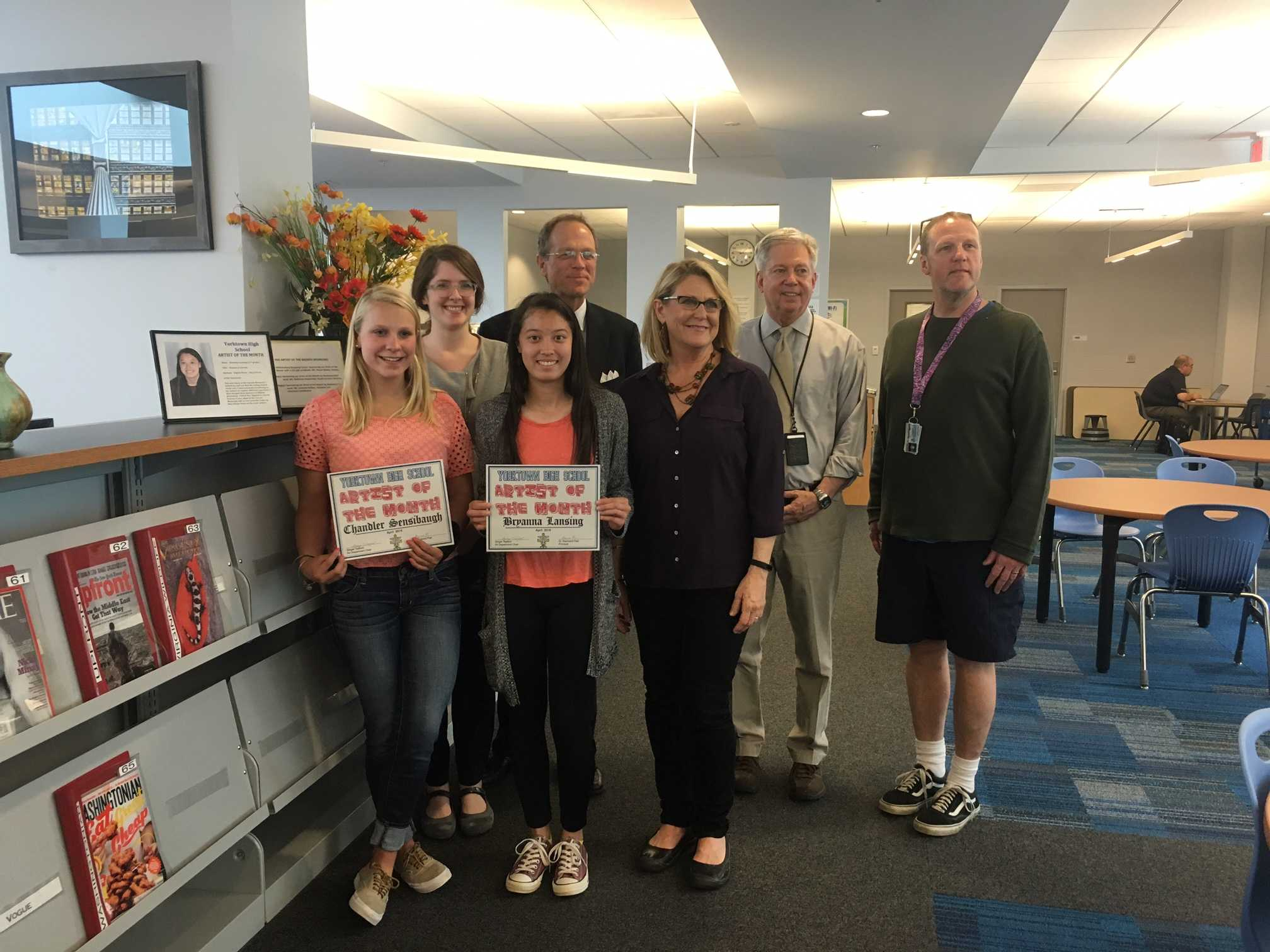 Juniors Chandler Sensibaugh (left) and Bryanna Lansing (front center left) accepting the award of Artist of the Month