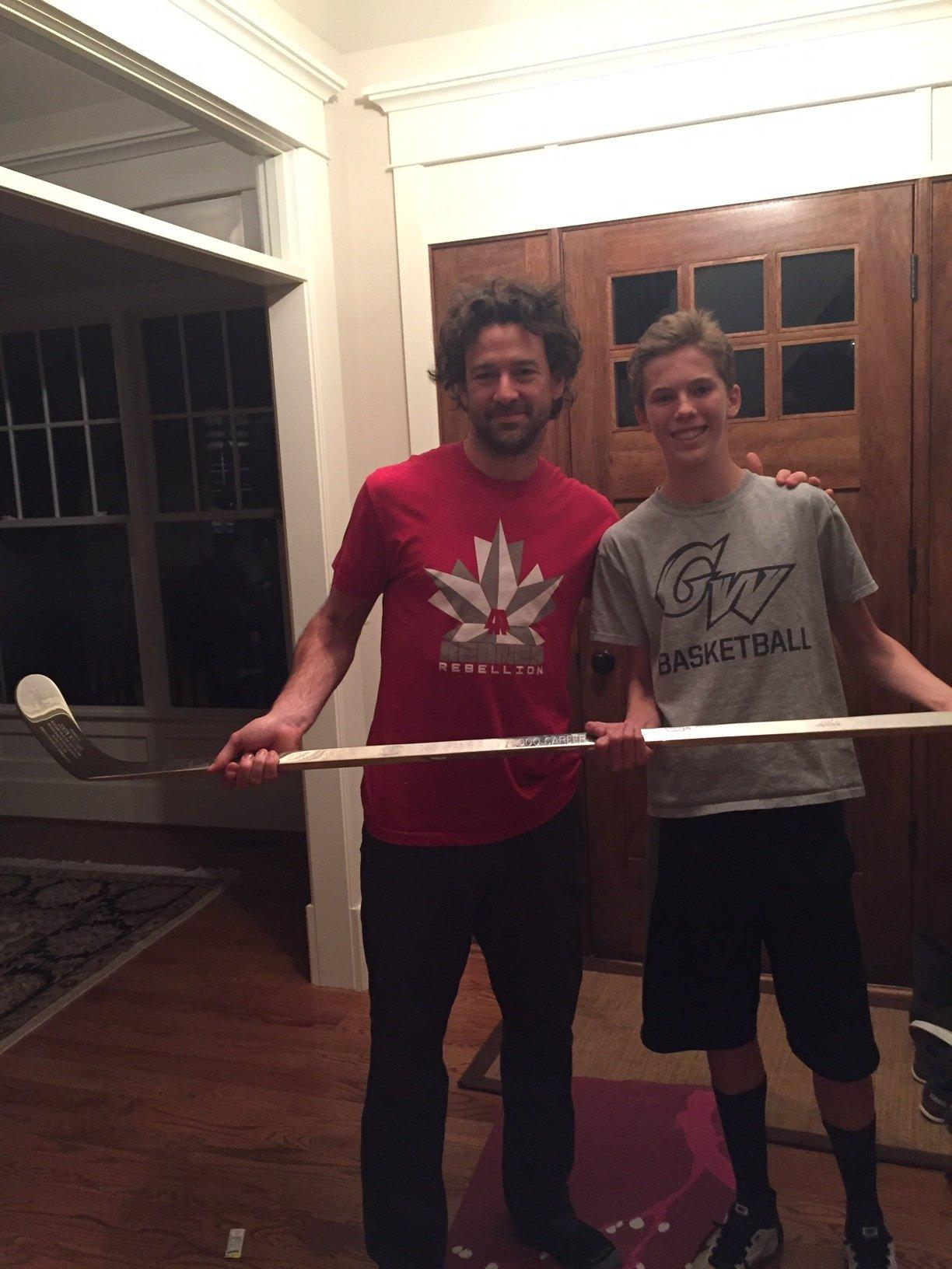 Sentry staff reporter Topher Wagner (right) and Washington Capitals right winger Justin Williams (left)