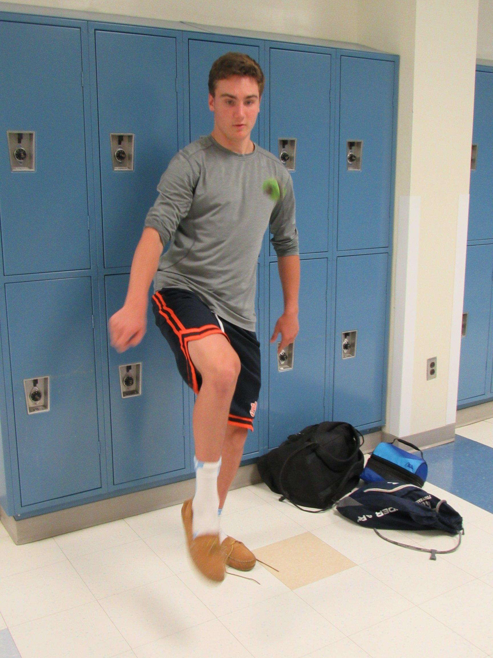 Junior Johnathan Best plays hacky sack during his lunch period