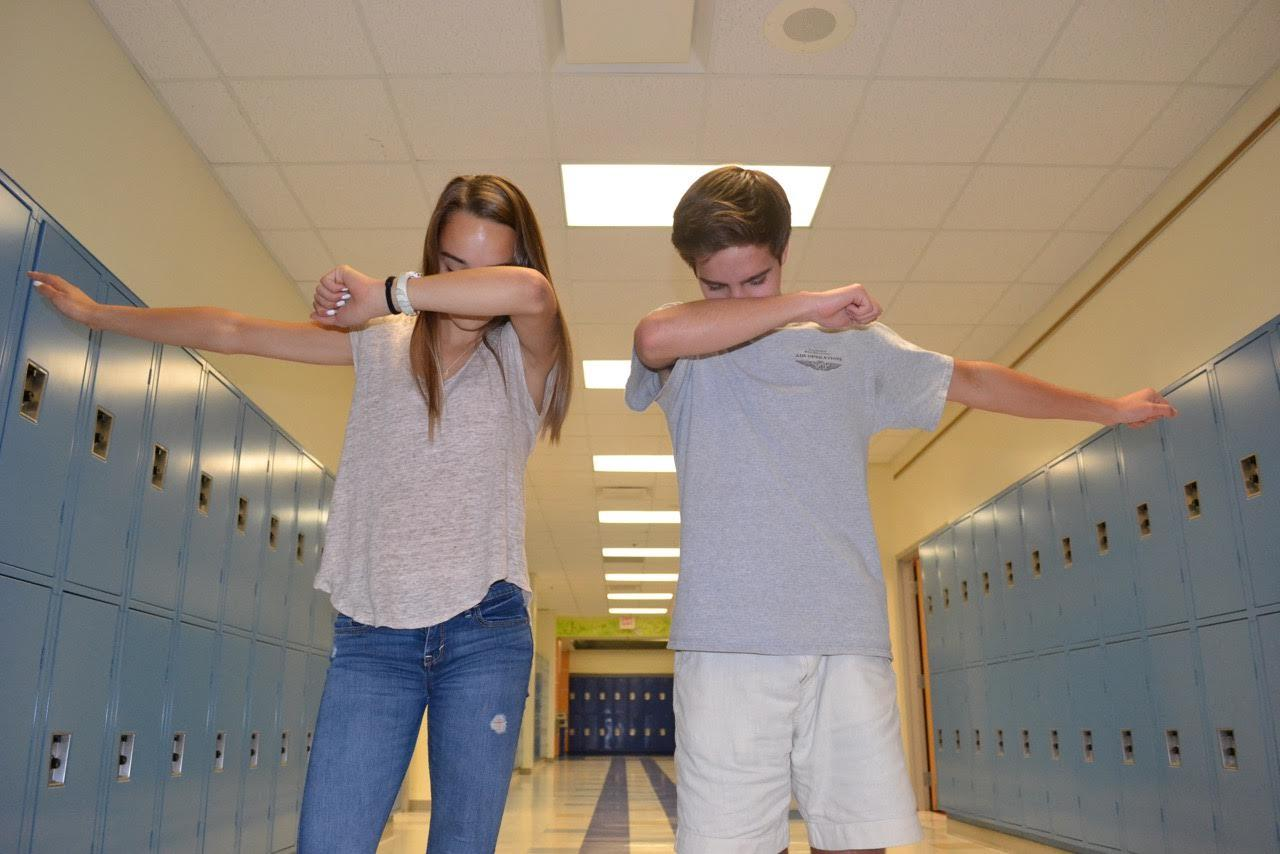 Bergen Romness and Alex Brandolino dab for the camera.
