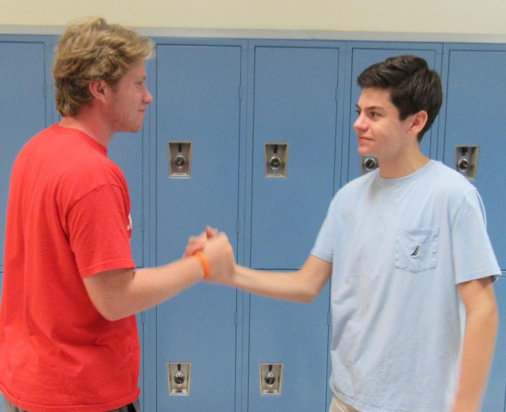 Jackson Cummings and Michael Lowen shake hands after finishing their interview