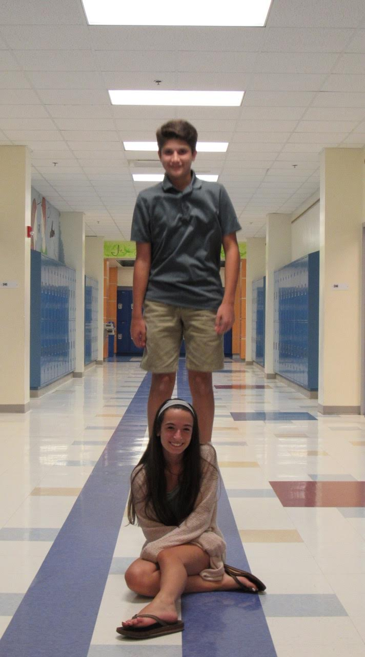 Matthew Cornfield and Jessie Moyer goof off in the hallway.