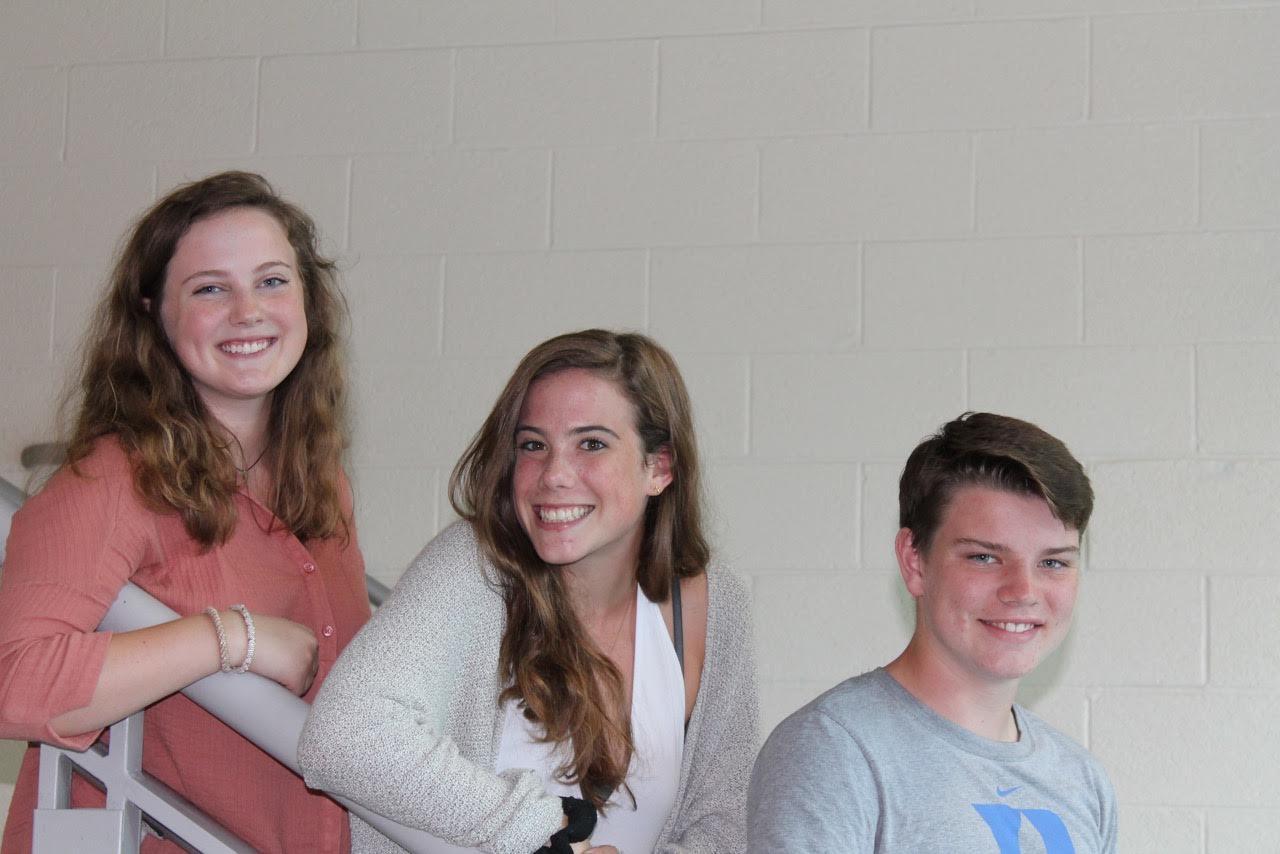 Julie Gilbertsen, Gigi Richardson and Ryan Van Kirk hanging out in the hallway.