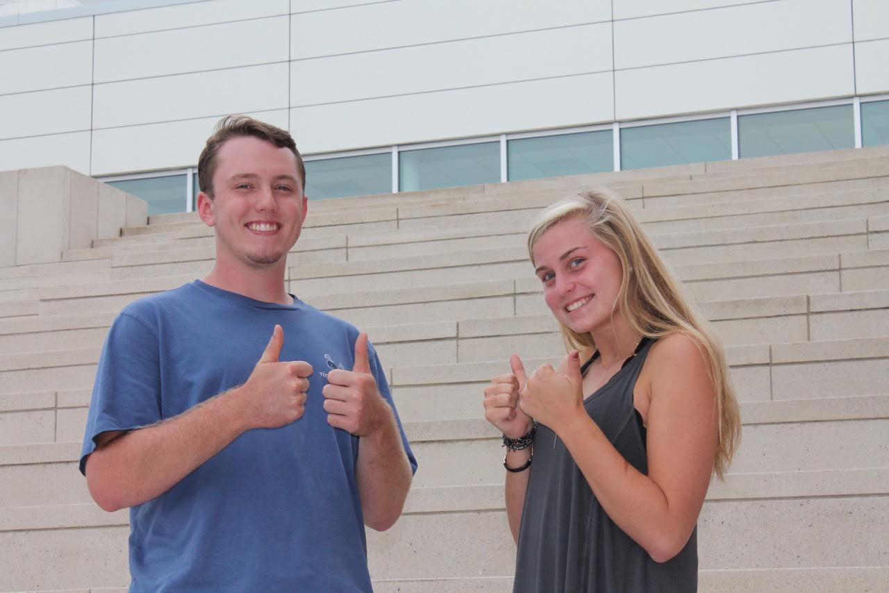 Lindsey Bowers and Ben Stoffel give the camera a thumbs up.