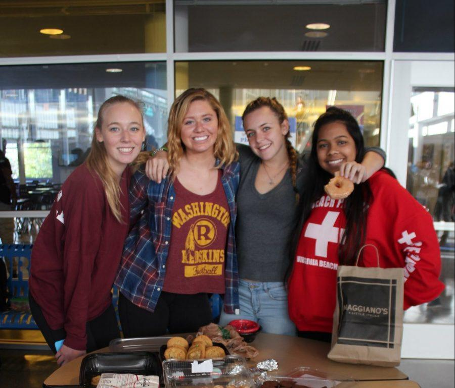 Kathleen+Columbia%2C+president+of+SASA+%28Students+Against+Sexual+Assault%29+helps+raise+money+through+a+food+drive