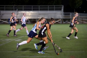 Midfielder Celeste Meadows goes head to head with a Herndon player. Photo by Ian Hardman