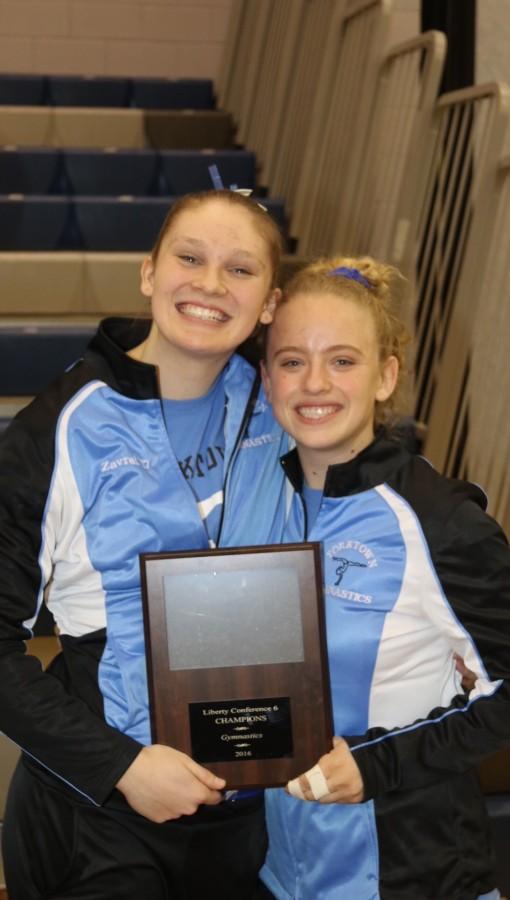 Yorktown gymnastics members, junior Olivia Zavrel (left) and junior Juliette Mitrovich
