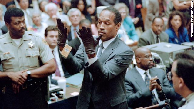 The now infamous photo of former NFL running back OJ Simpson trying on the gloves found at the scene of his ex-wife's murder during his trial