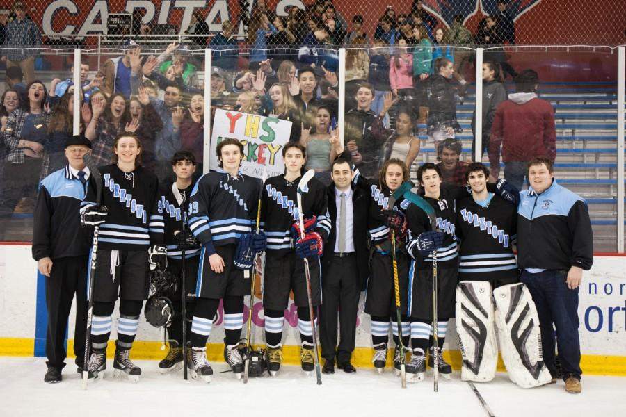 The seniors of the Yorktown hockey team stand victorious after their 5-3 win over Washington-Lee