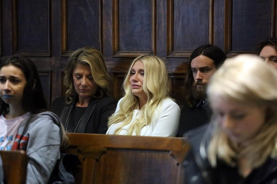 Kesha (center) crying at the ruling of her case against Dr. Luke