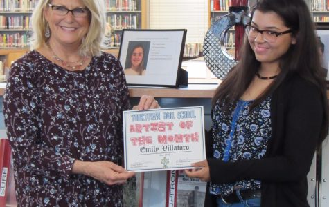 Senior Emily Villatoro receiving her award