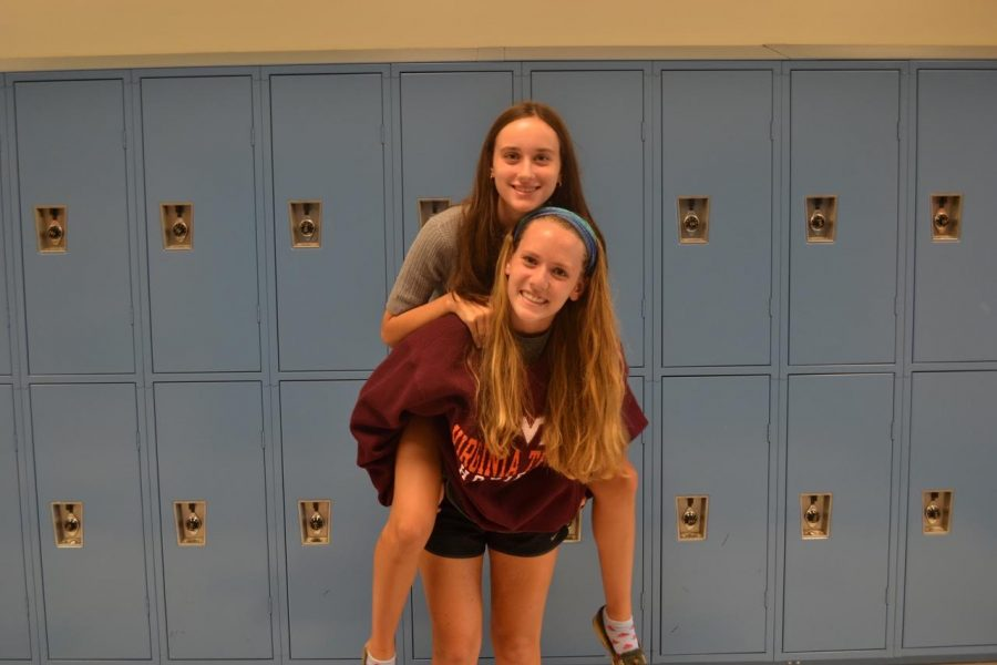 Emily+Calvert+and+Sophie+Dalton+giving+piggy-back+rides+for+the+camera.