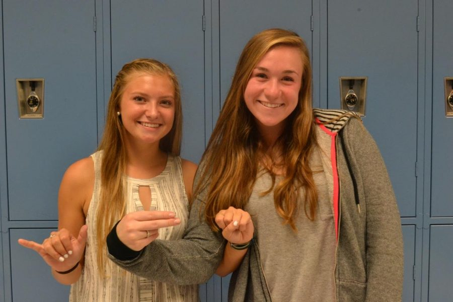 Sydney+McMahon+and+Kate+Cressey+spell+out+%22YHS%22+in+Sign+Language.