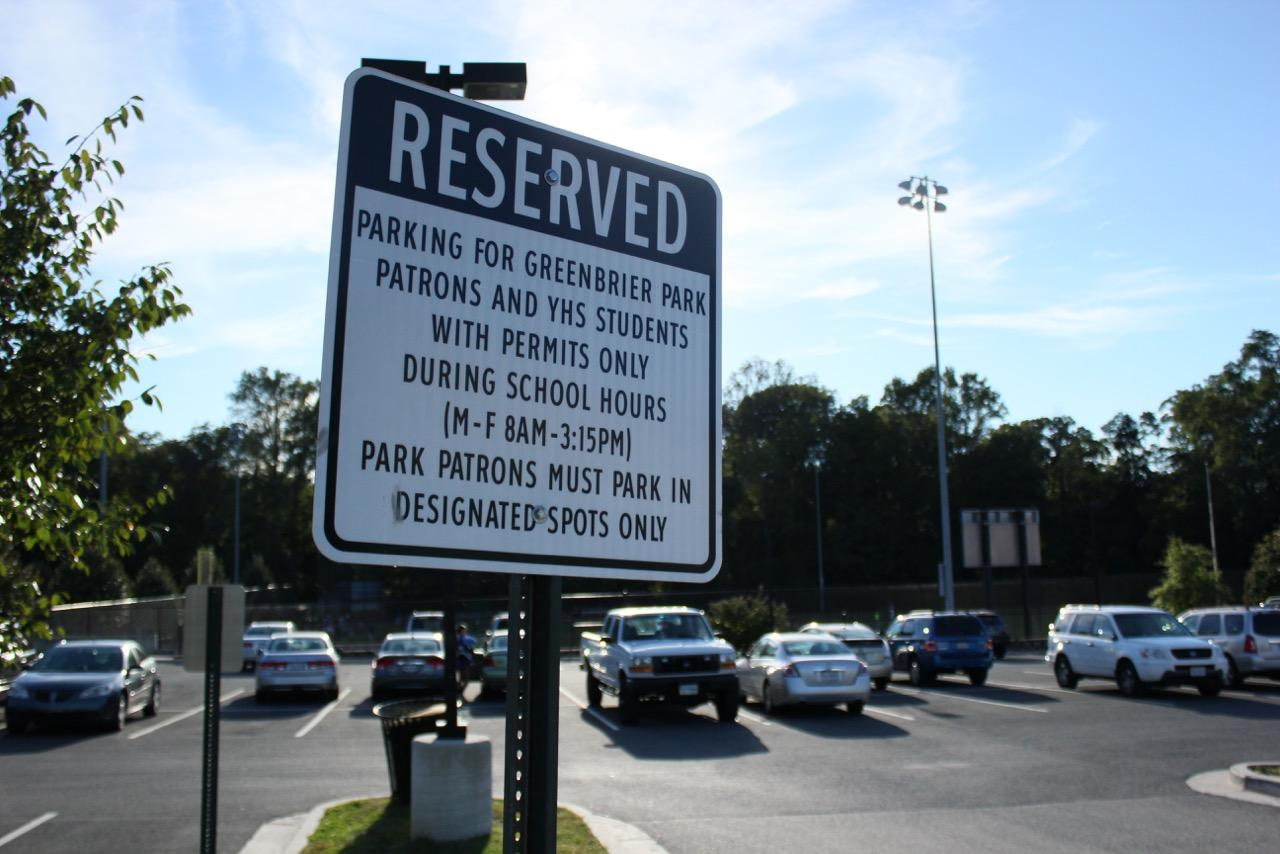 A sign outside the senior lot showing you need a permit to park there