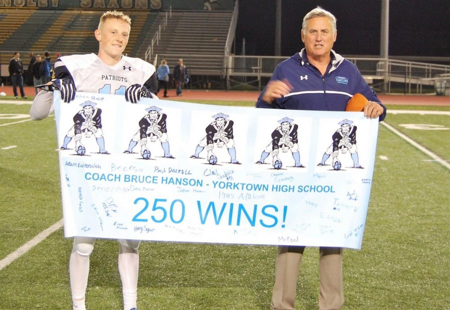 Tanner Wall celebrates Coach Hanson's 250th win.