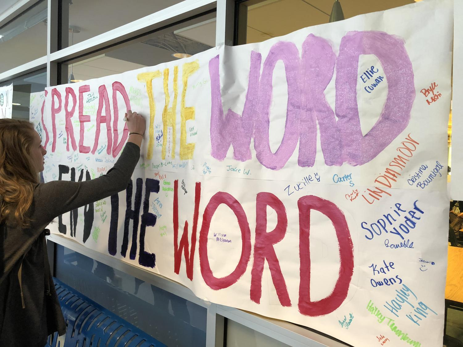 Students signed a banner to symbolize taking the pledge