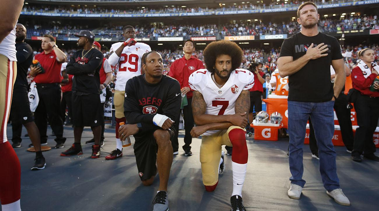 Colin Kaepernick kneels despite recent controversy.