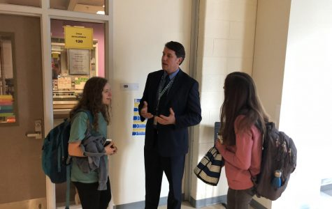 Mr. Conroy as he talks to students in the hallways.