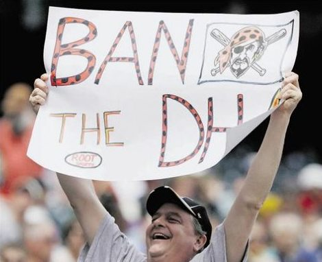 Fan holds sign against designated hitters.