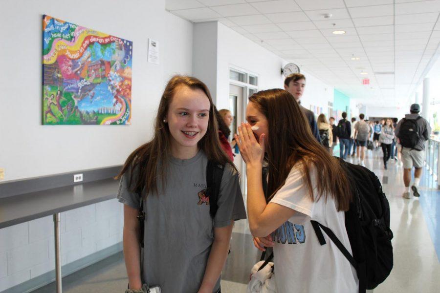 Girls tell secrets in the halls