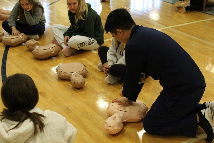 Instructors showed students how to properly perform CPR.