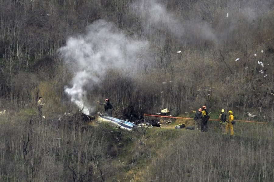 Firefighters at the scene of the helicopter crash.