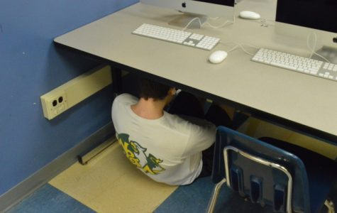 Kids during active shooter drills are forced to crouch under desks.