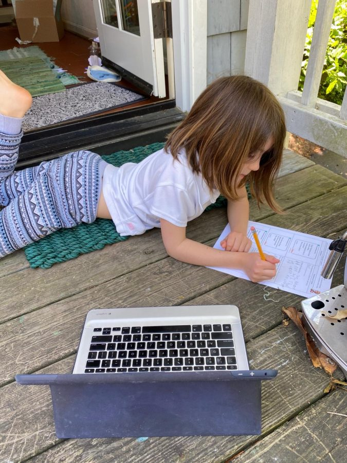 Second grader Willa Stroup doing her daily school work outdoors