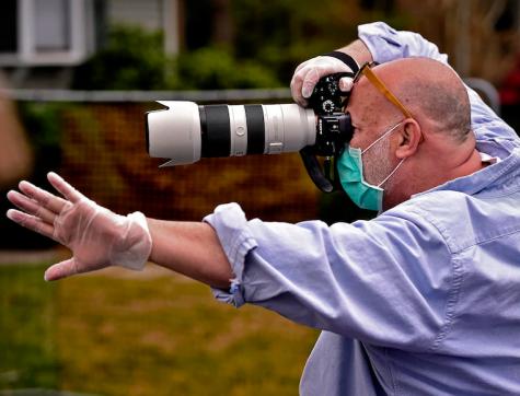 Photographer Matt Mendelsohn taking a portrait of a Yorktown senior.